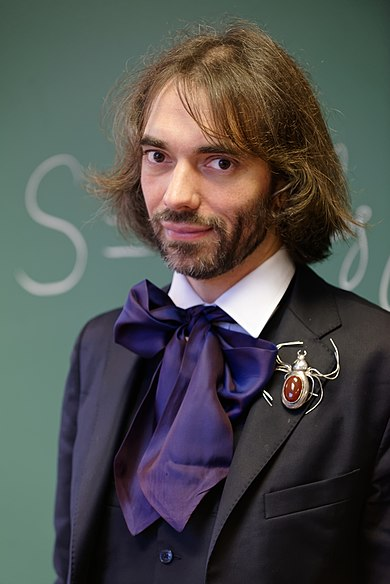 390px-Cedric_Villani_at_his_office_2015_n3